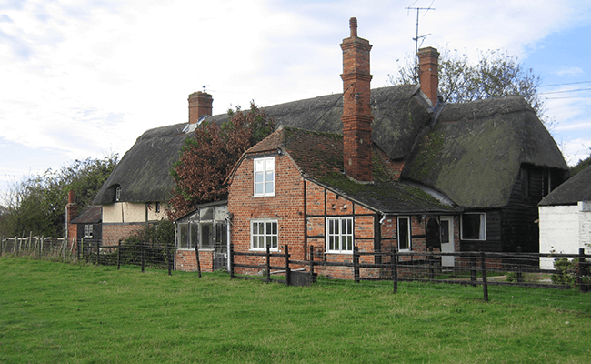 Large thatched farmhouse near Witney